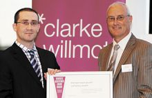 Chris Derret collecting business award